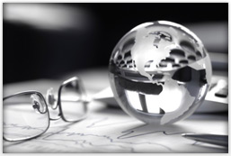 A glass globe rests above data charts.