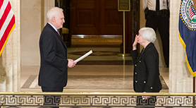 Chair Janet L. Yellen takes the oath of office, administered by Governor Daniel K. Tarullo, at her ceremonial swearing-in. The event took place at the Federal Reserve Board in Washington, D.C., on March 5, 2014.